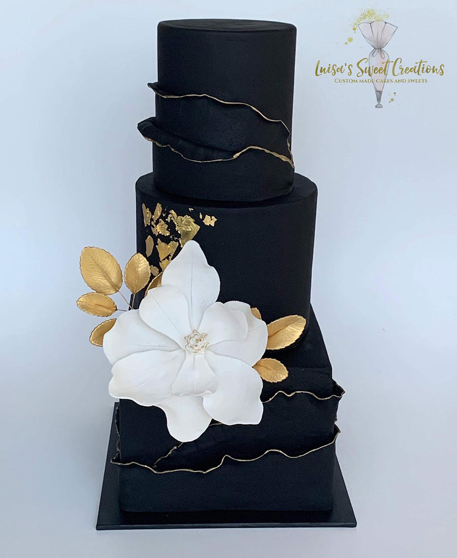 Black wedding cake Brisbane with gold detail and flower topperby Luisa's Sweet Creations