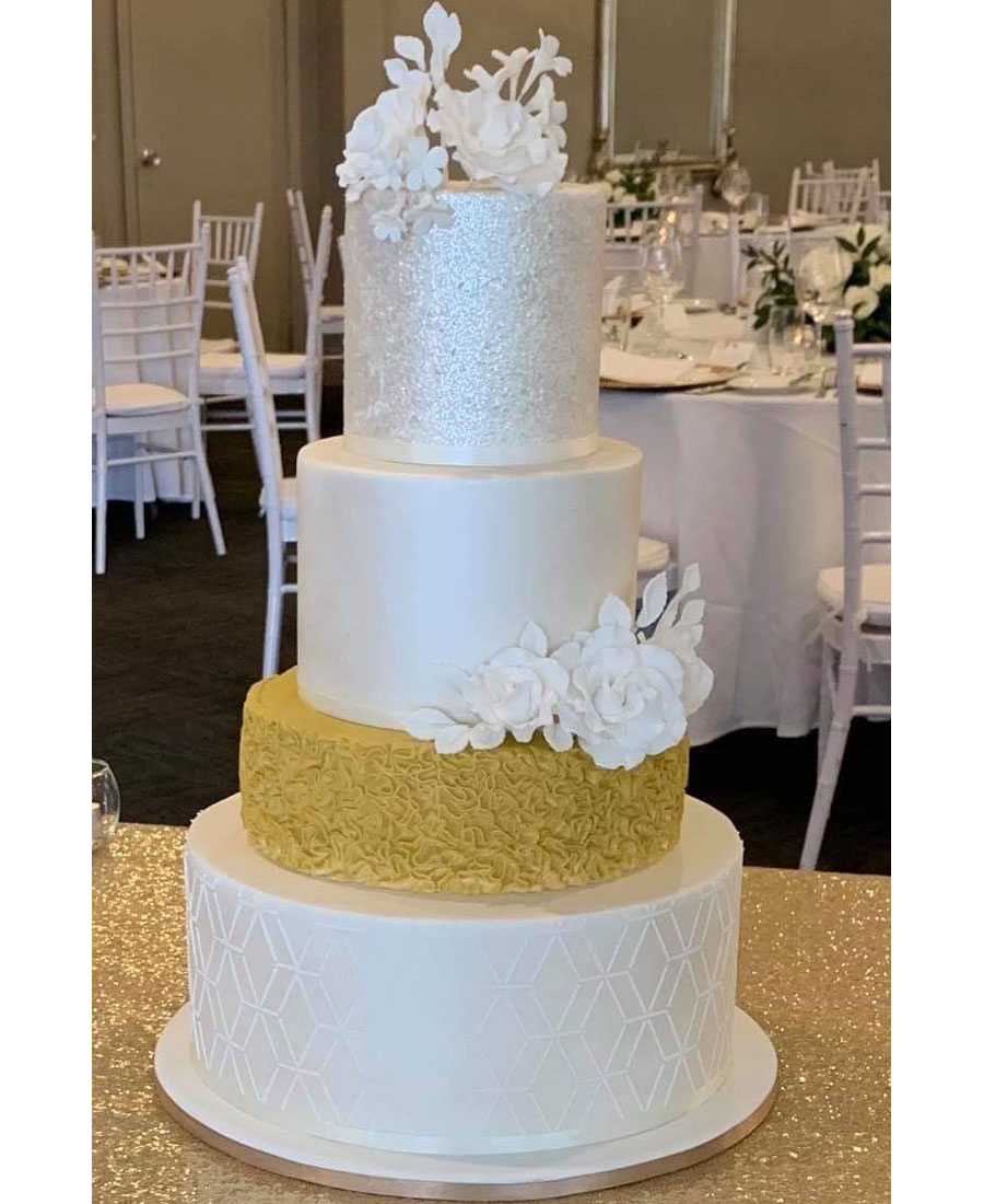 Four tier wedding cake Brisbane with textured detailby Luisa's Sweet Creations