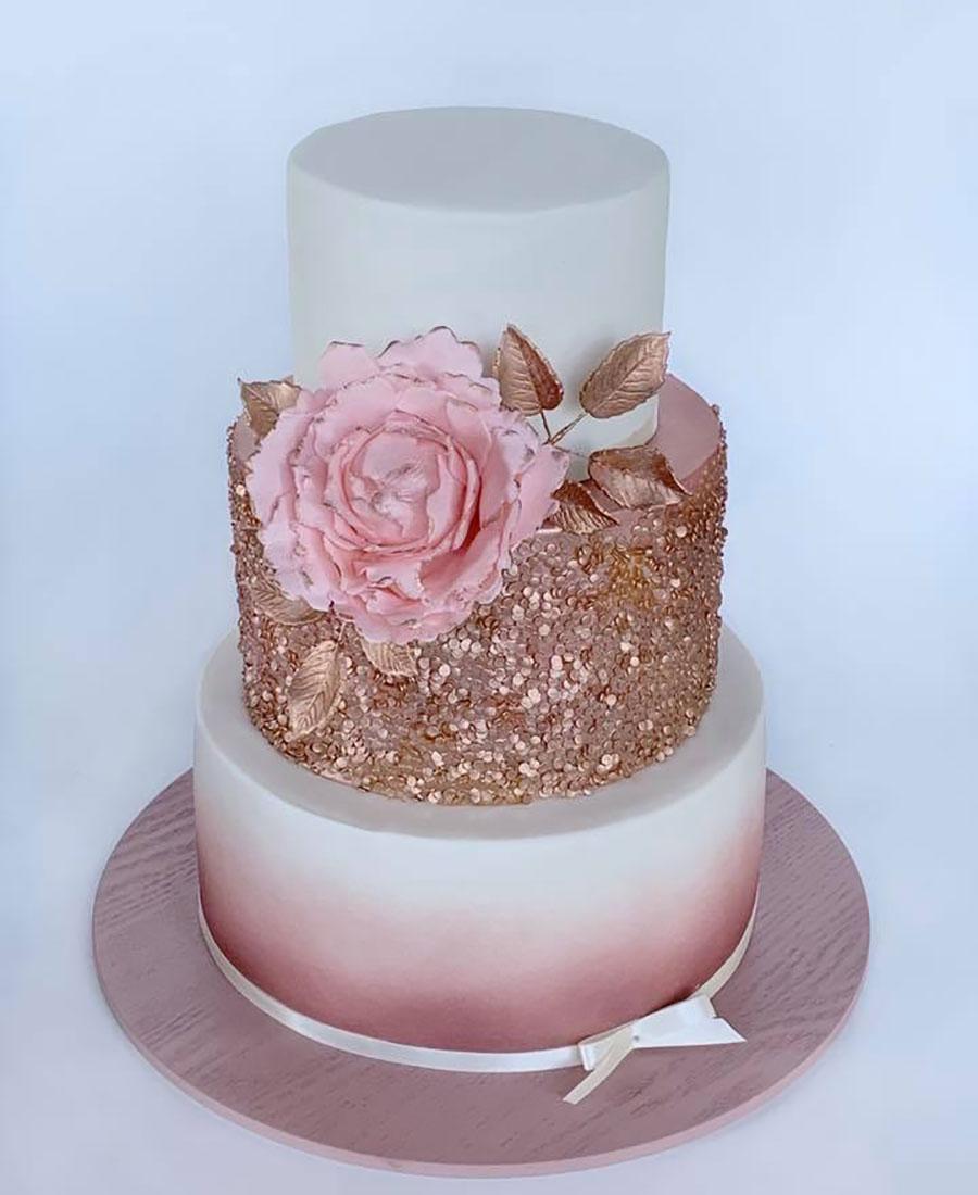 Rose gold wedding cake with fresh flowersby Luisa's Sweet Creations Brisbane