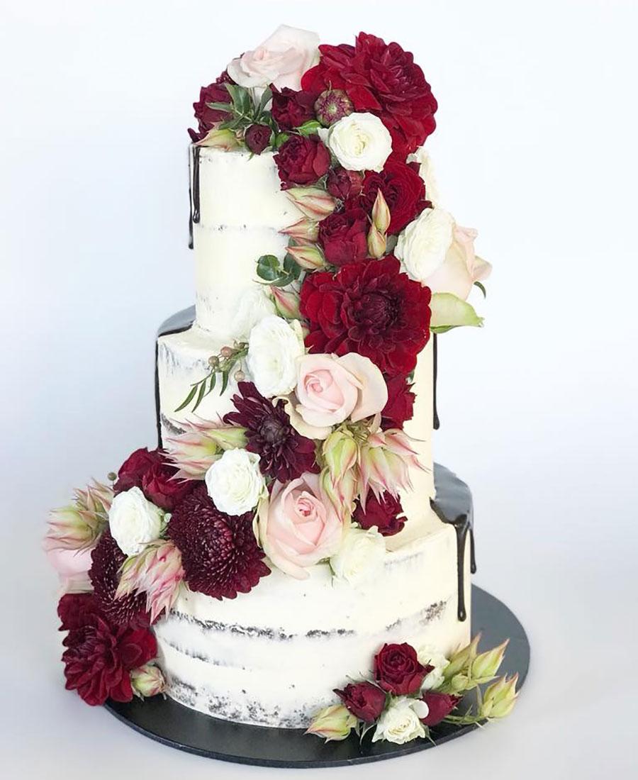 Wedding cake Brisbane with red flowersby Luisa's Sweet Creations Brisbane