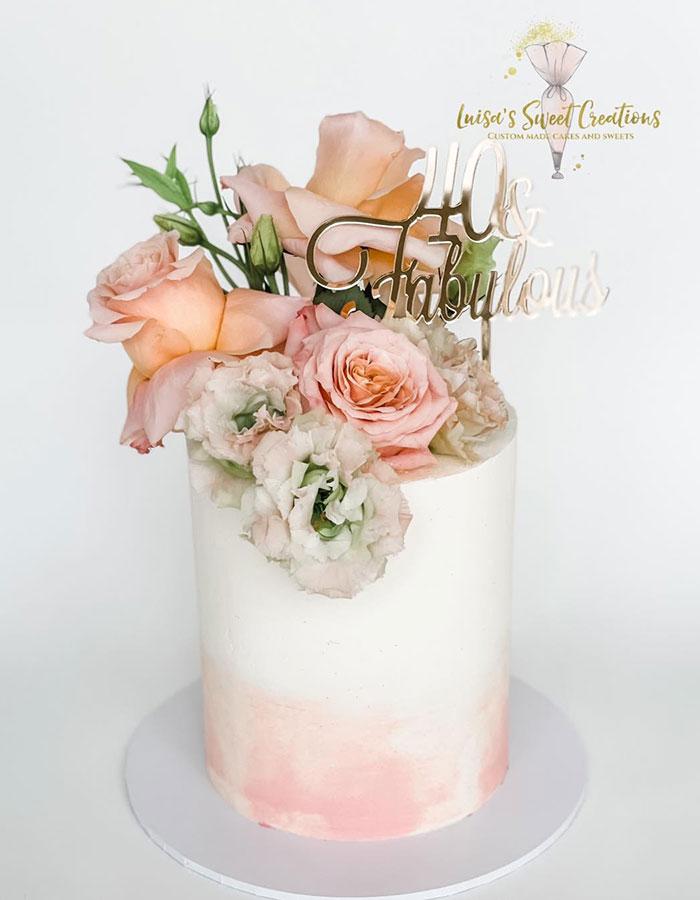 Kenmore Village Florist flowers on cake by Luisa's Sweet Creations