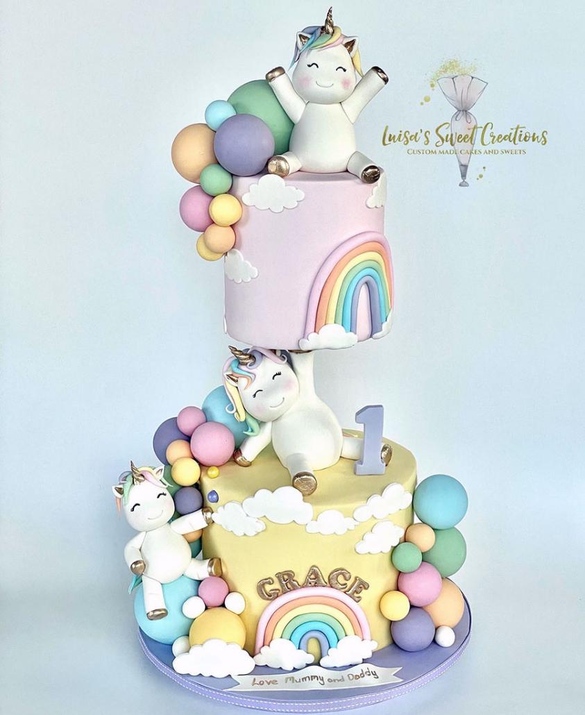 Rainbow and unicorns first birthday cake by Luisa Nodari Brisbane